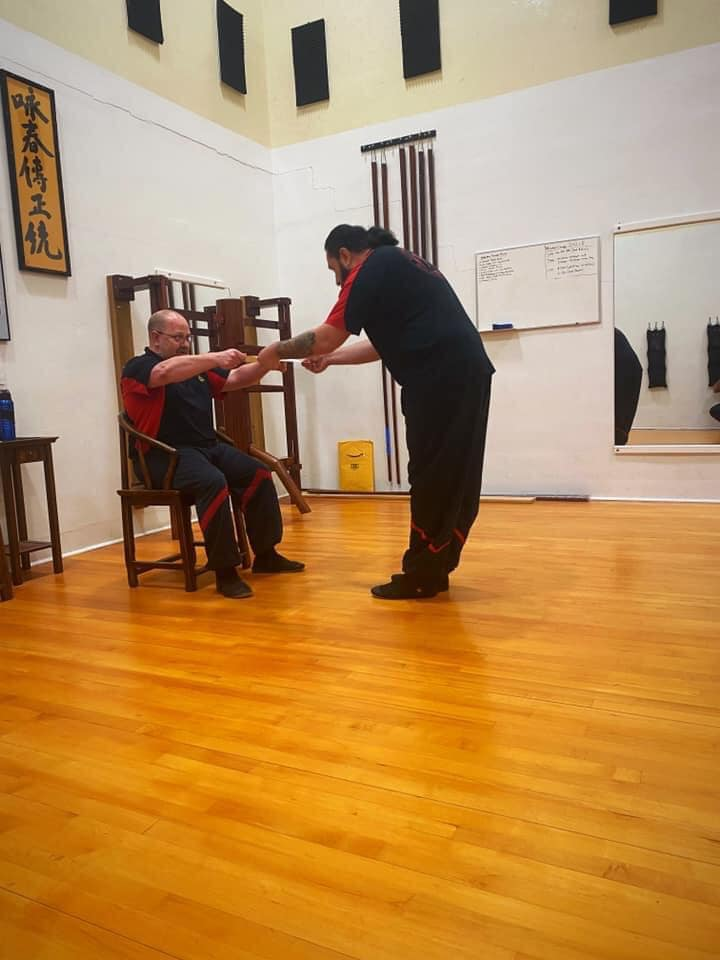 Sifu Eric Receiving his Certificate for his 3rd Degree in Ving Tsun