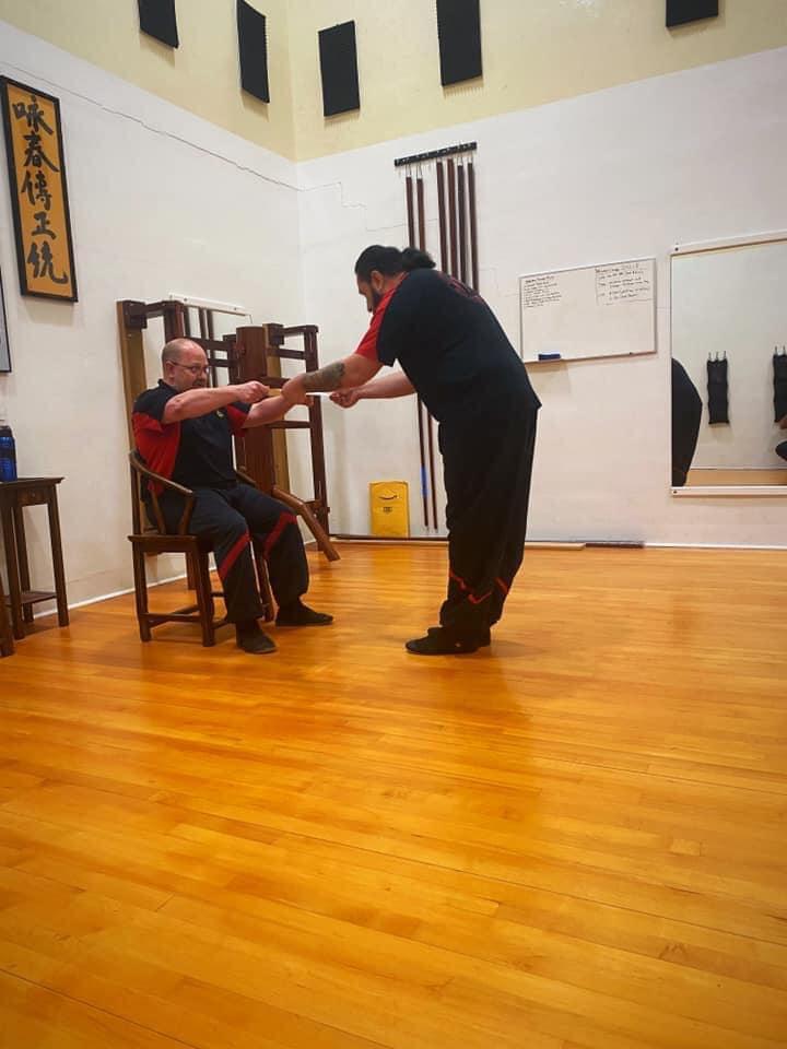 Sifu Eric Receiving his Certificate for his 3rd Degree in Ving Tsun